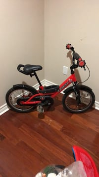 toddler's red and black bicycle with training wheels Toronto, M5M