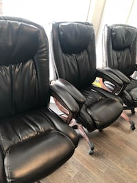 black leather padded rolling armchair 562 km