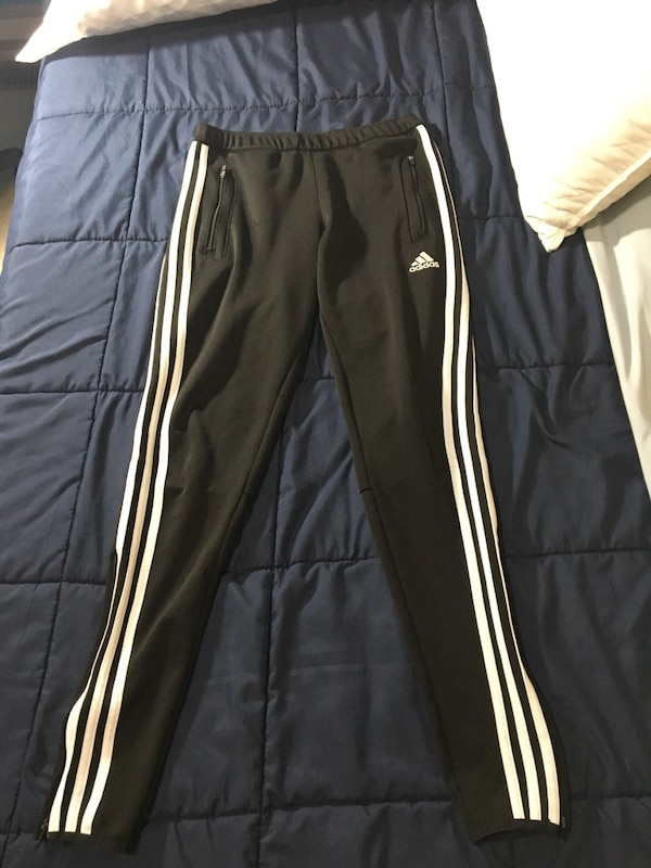 white and black Adidas track pants