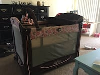 brown and pink Graco pack and play sleeper