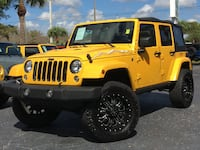 Yellow Jeep Wrangler Unlimited Sahara X Fort Myers
