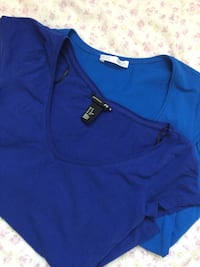 Two blue v-neck tops $5forboth Calgary, T2W 2E6