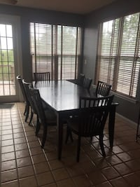 Beautiful large dining table with 8 chairs and custom table pad. Table is in very good condition with minimal wear and tear. Table pad in excellent condition. Chair pads in used condition with some staining, easily could be recovered.  95 long x 45 wide,  Leesburg, 20175