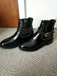 pair of black leather studded boots Victoria, V8R 4N2
