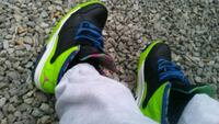 pair of black-and-green Nike basketball shoes Detroit, 48231