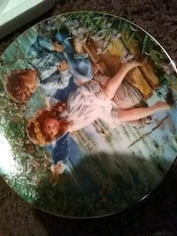 boy and girl sitting on yellow chair decorative ceramic plate Midvale, 84047