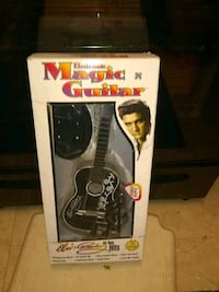Magical guitar plays Elvis songs battery operated Alexandria, 22306