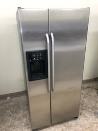 33x70 Ge stainless steel side by side refrigerator it works great 100 days warranty Baltimore, 21222