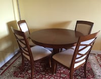 round brown wooden table with four chairs dining set New York