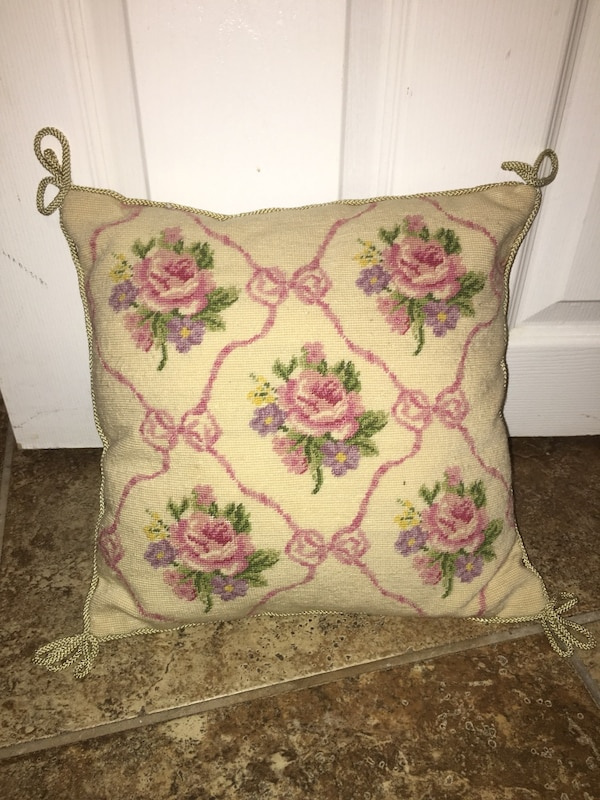 Pink and white floral decorative pillow