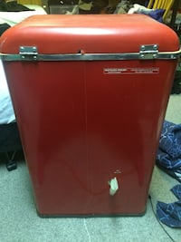 red and black Haier compact refrigerator