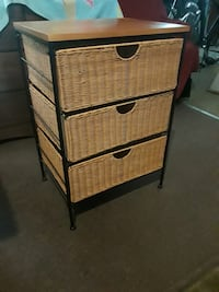 Three drawer wicker chest of drawers.
