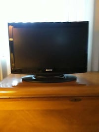 black flat screen TV with remote 1697 mi