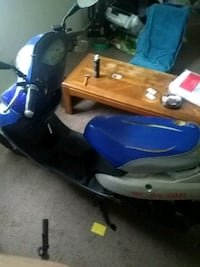 blue and white motor scooter Elwood, 46036