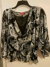black and white floral long-sleeved shirt 552 km
