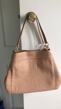 Brand New Coach purse bag paid $500 mother in law didn't like it, can't return no receipt. In smoke free and pet free home pickup Kennedy and sandalwood Brampton, L6Z