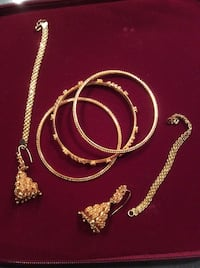 Set of artificial gold bangles and earrings Richmond, V6X 2V7