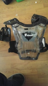 gray and black plastic thro chest protector Mount Brydges, N0L 1W0