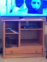 brown wooden TV hutch with flat screen television Davenport, 33897