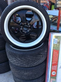 Black 6 spoked car wheel with tire 5 lugs