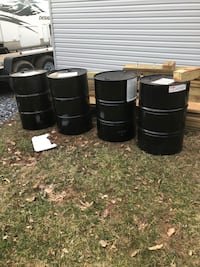55 gallon drums water tight or could be used as burn barrels like new