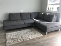 Gray fabric sectional sofa. 4 years old. Made in Canada still under warranty. Port Coquitlam
