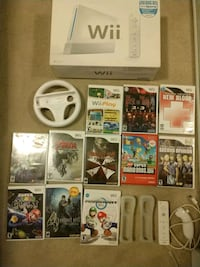 Wii + 2 controllers + 2 nunchuks + lots of games + racing wheel Toronto, M5G 0B2