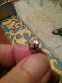 unpaired silver-colored stud earring