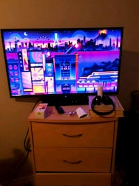 black flat screen TV with remote Cambridge, N1R 5H8