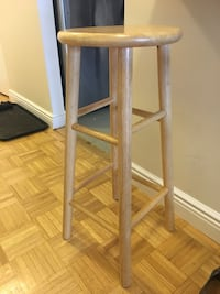 two brown wooden bar stools New York, 10021