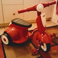 red and white Radio Flyer trike Palm City