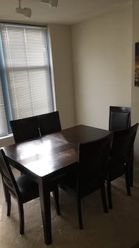 Rectangular brown wooden table with six chairs dining set Arlington, 22202
