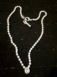 white stone necklace.
