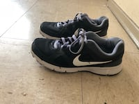 Pair of black nike running shoes9 1/2 Winnipeg, R2L 1P8