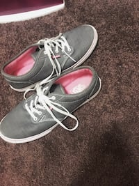 gray-and-white Vans low-top sneakers
