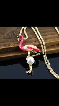 Pink Flamingo & Pearl Necklace Jewelry New condition Payment cash only Pick up location: near Main St./Fraser St. & 49th Ave., South Vancouver No deliveries/only pick ups