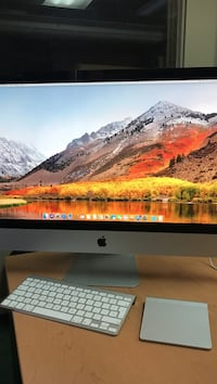 silver iMac with Apple Magic keyboard and touchpad