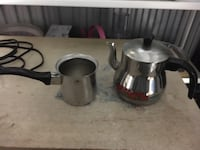 two stainless steel cooking pots 39 km