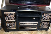 Asian tv stand including a cabinet and mirror