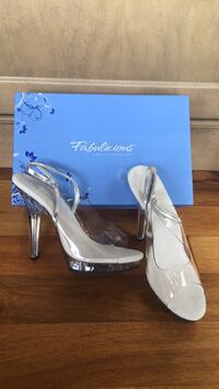 pair of white leather platform stilettos Calgary, T2N