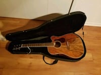 brown acoustic guitar with case Howell, 48843