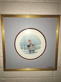 girl in purple and gray holding sheep painting with brown wooden frame