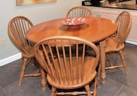 round brown wooden table with four windsor chairs Alexandria, 22307