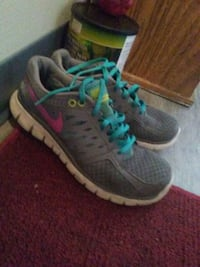 pair of gray-and-pink Nike running shoes Vancouver, V5K 4P1