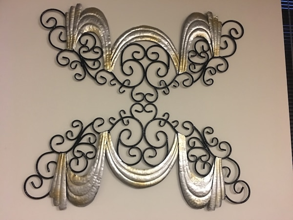 two black and brown wall decors
