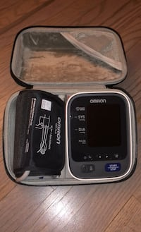 Automatic blood pressure machine with a case