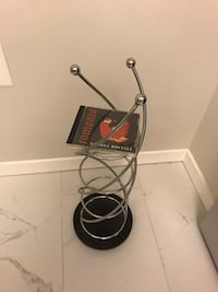 CD holder- spins, holds 6 CDs per shelf,has 4 shelves Alexandria, 22301