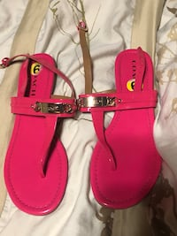 pair of pink leather sandals Spruce Grove, T7X 2A8
