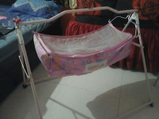 Pink color cradle from Firstcry