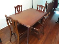 rectangular brown wooden table with four chairs di Mississauga, L5M 0C4